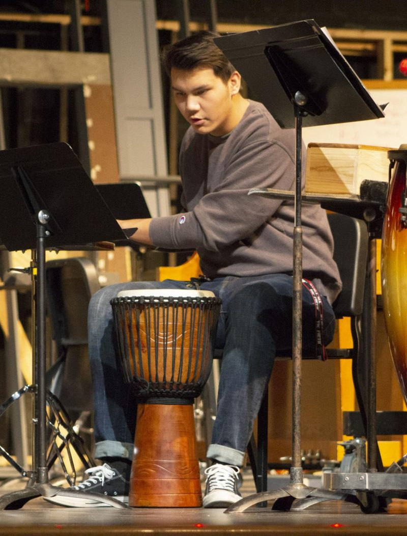 Isaac Pham practices for the Nebraska Music Educators Association Conference