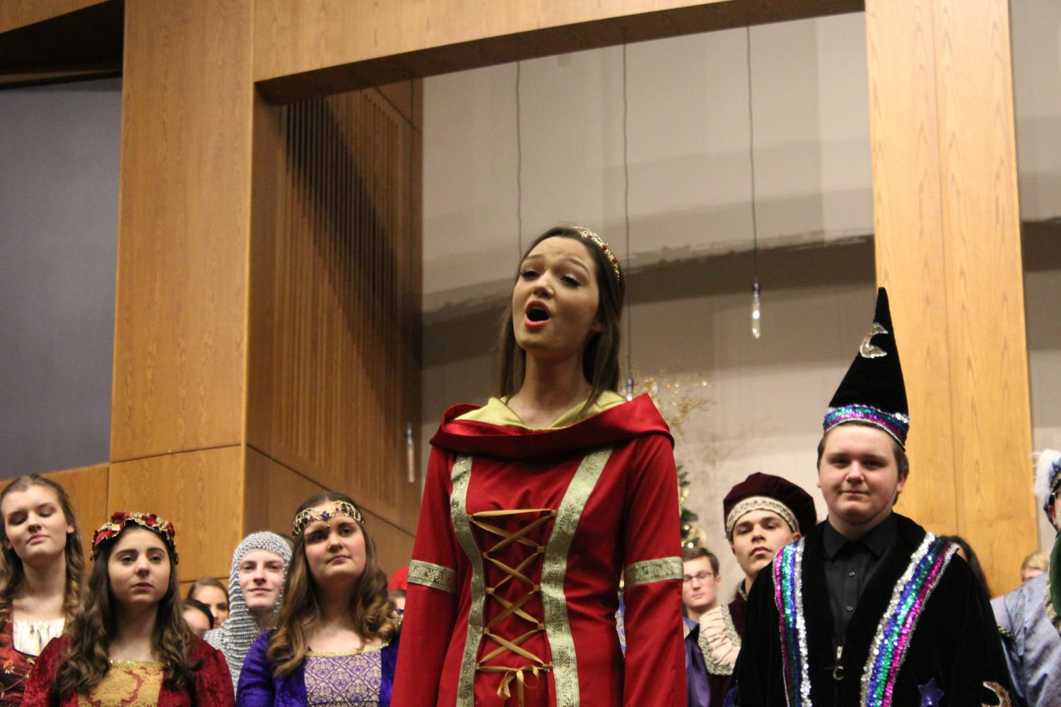 Morgan Murphy, Queen of the Bel Canto Choir, stands in front of her peers and preforms one of their winter songs. For several years Bel Canto has hosted the Winter Concert. Not only have they performed, but they have also featured the other eight choirs.