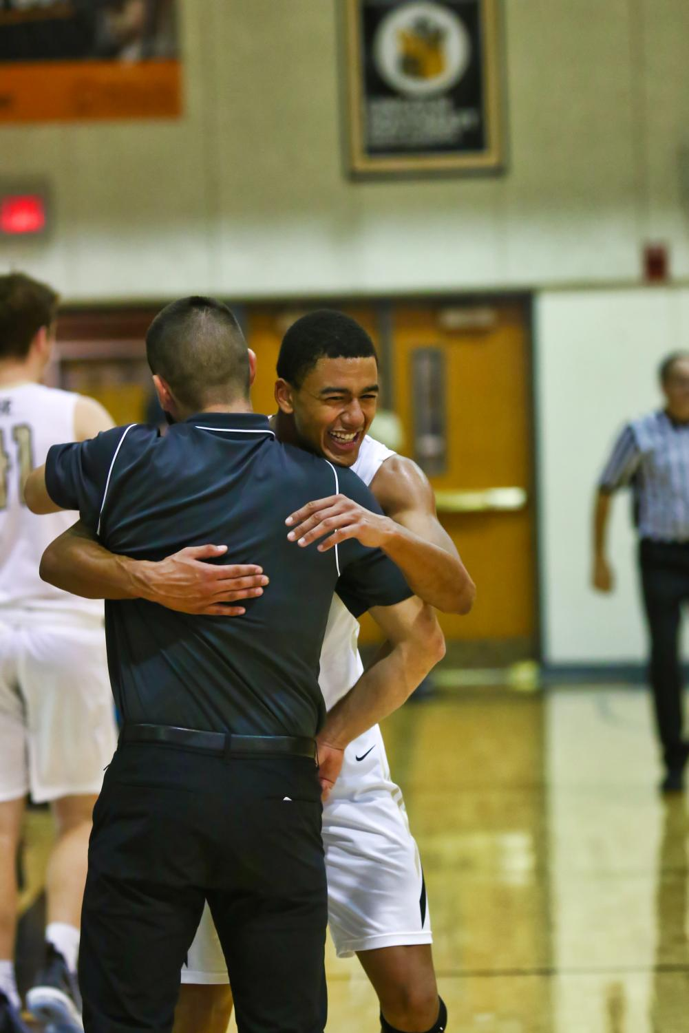 Senior Michael Anderson celebrates with Southeast Head Coach Jonah Bradley at the game against Bellevue West on Saturday Dec. 8.