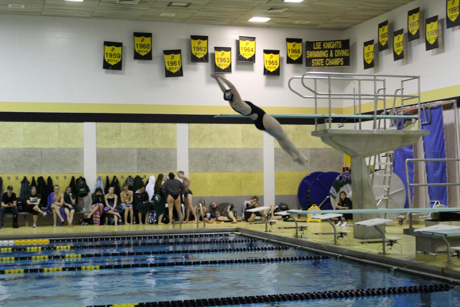 Rose Kaup completes backwards dive at the Millard West meet.
