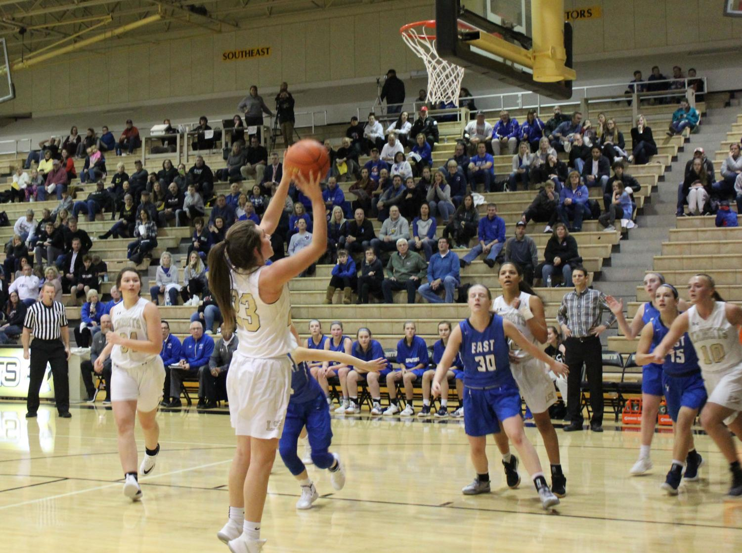 Meg Hatfield attempts a two point shot against East during the game on Friday, Jan. 11.