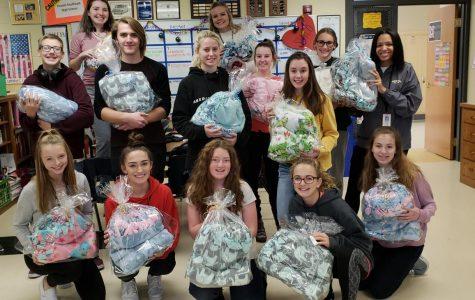 Leadership class donates handmade tie-blankets to Children's Hospital of Omaha