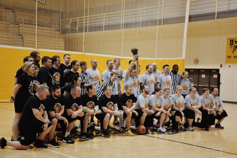 Both teams pose for pictures after the Dunks for Dollars game. The gray team (coached by Heather Leader) won the game.
