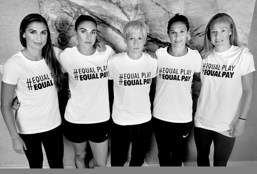 The+U.S.+women%E2%80%99s+soccer+team+is+using+the+slogan+%E2%80%9CEqual+Play+Equal+Pay%E2%80%9D+to+promote+their+wage+fight.+From+left%2C+Alex+Morgan%2C+Hope+Solo%2C+Megan+Rapinoe%2C+Carli+Lloyd+and+Becky+Sauerbrunn.