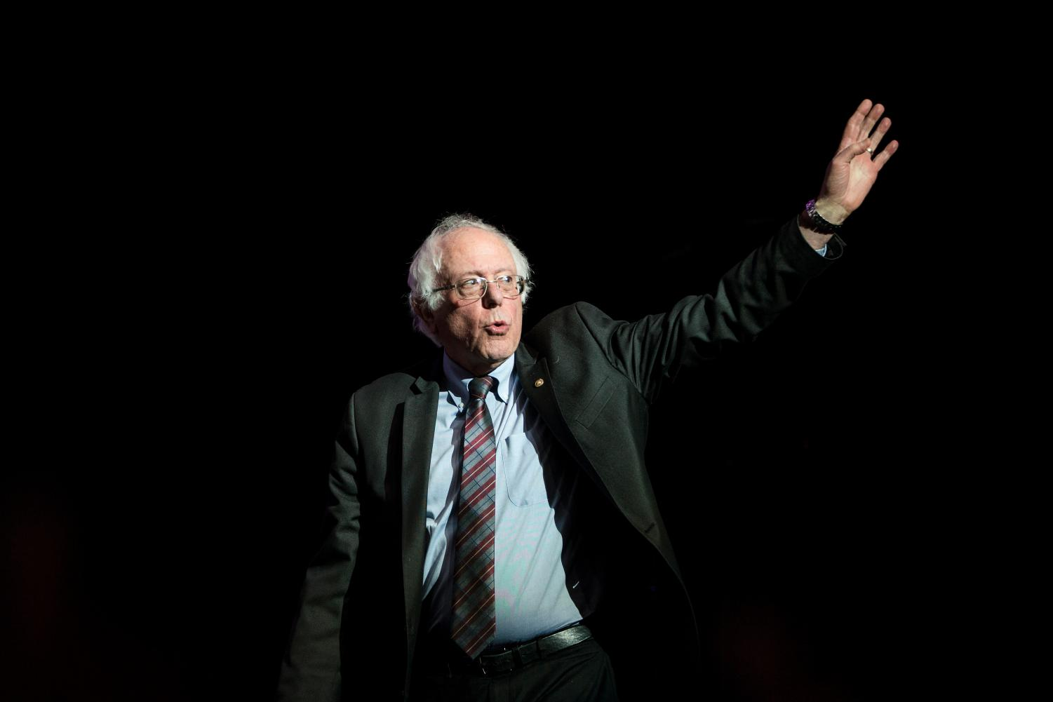 Sen. Bernie Sanders waves as he takes the stage at the Our Revolution Massachusetts Rally in Boston, Mass., on March 31, 2017. Photo: Scott Eisen/Getty Images