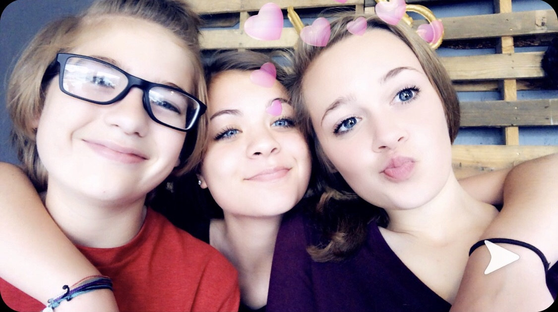 Freshman Stasia Garrison taking a group selfie with her brother and her friend, Kylie Thiessen (9), while spending time with them over the summer.