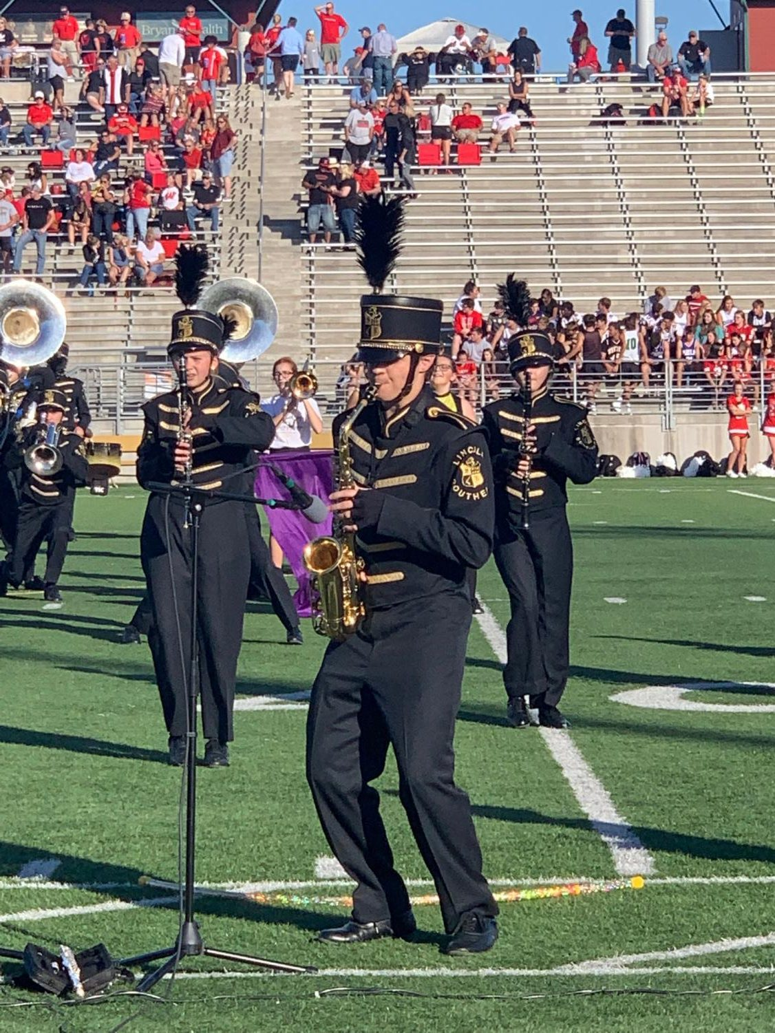 Senior Colton Harris playing his alto saxophone during his marching band solo