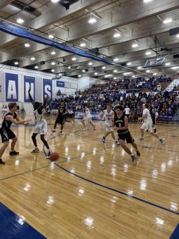 Varsity boys basketball wins first inner-city game of the season