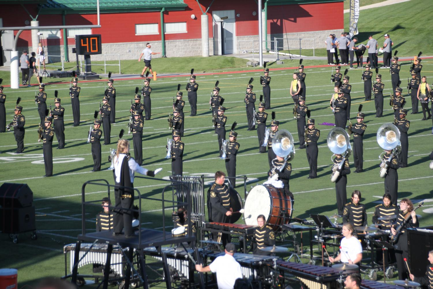 Junior Rachel Odabasi conducts the Marching Band during last season's show.