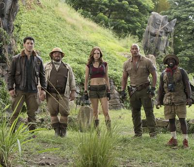 (l to r) Nick Jonas, Jack Black, Karen Gillan,  Dwayne Johnson and Kevin Hart  star in JUMANJI: WELCOME TO THE JUNGLE.