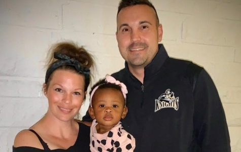 Principal Tanner Penrod with his wife, Meg, and daughter, Sloan.