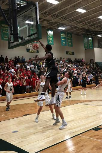Ajantae' Hogan dunks the ball at a game against Pius X during his Freshman year. During his four-year career playing basketball at LSE, Hogan made history by scoring more than 1,000 points.  Image by: Tyler Vander Woude