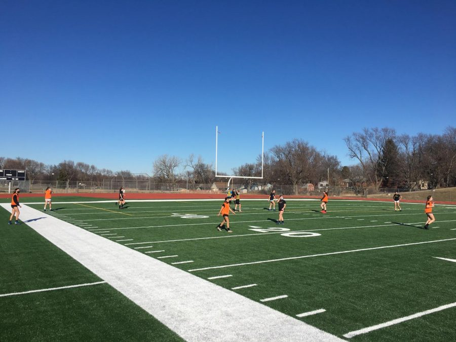 LSE girls soccer gets out onto the new turf field for a scrimmage. Photo Credit: Chris Rajala