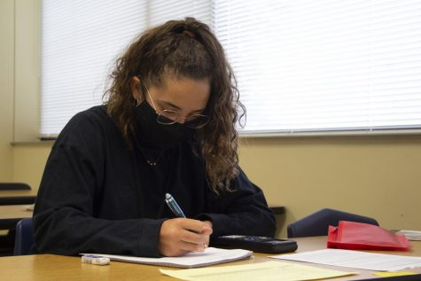 Junior Kélaine Levesque at Lincoln Southeast High School focusing on  assignments.